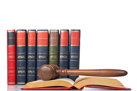 gavel-over-the-opened-law-book-thumb4821807